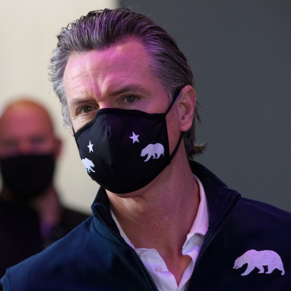California Gov. Gavin Newsom wears a face mask as he prepares to give a briefing after touring a COVID-19 vaccination site on February 22, 2021 in Long Beach. (PATRICK T. FALLON/AFP via Getty Images)