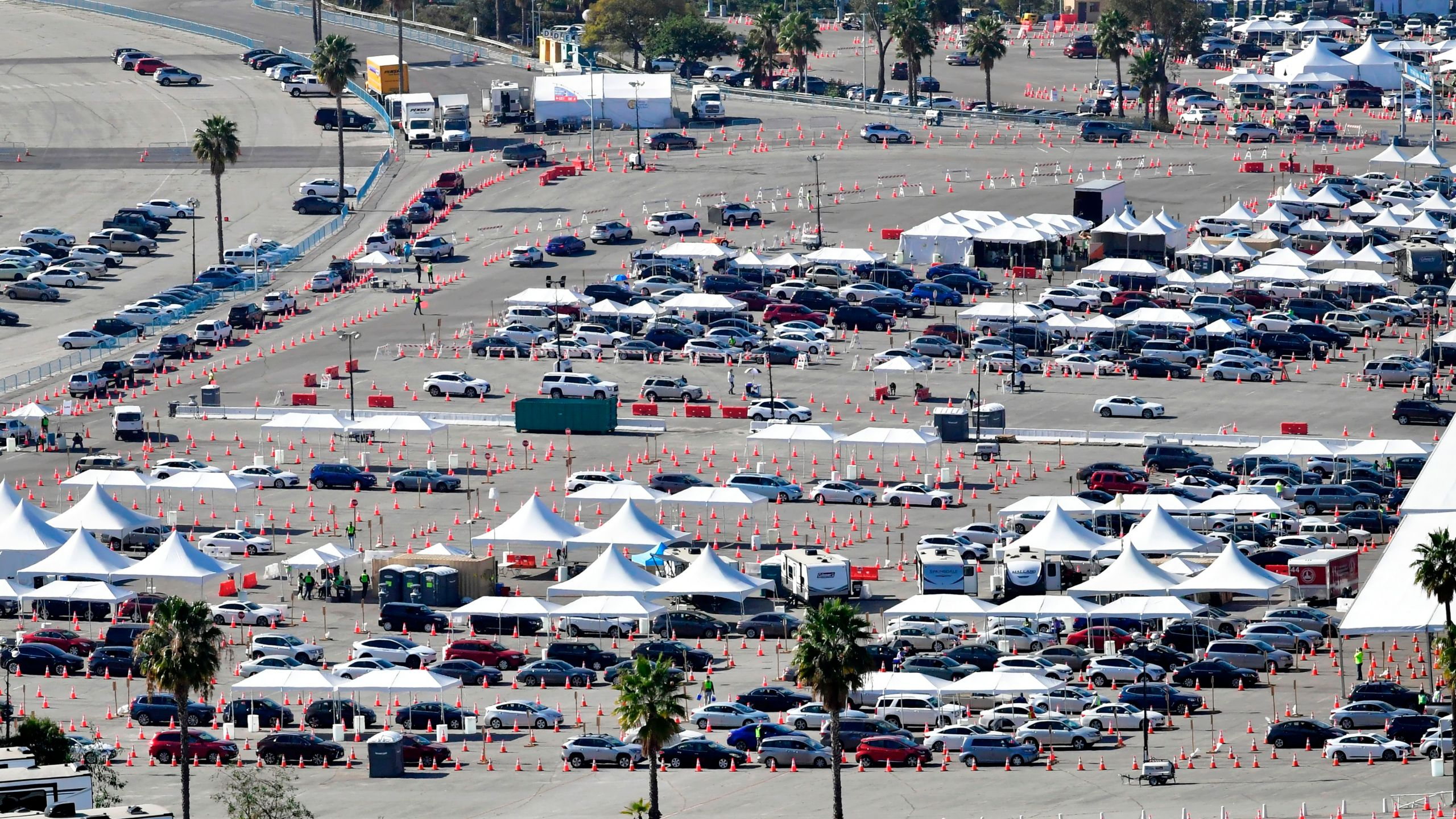 People in vehicles wait in line for their COVID-19 vaccinations in the parking lot at Dodger Stadium in Los Angeles, California on Feb. 25, 2021. (FREDERIC J. BROWN/AFP via Getty Images)