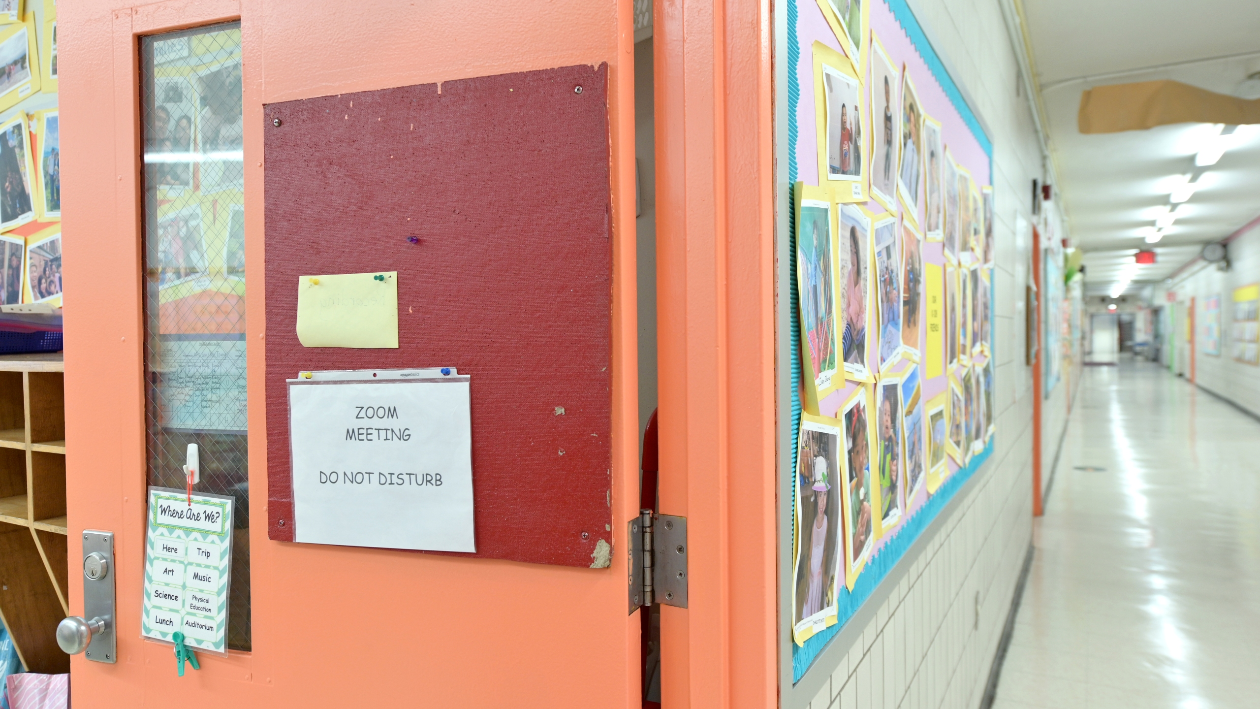 "A ""do not disturb"" sign for zoom sessions is posted on a classroom door during the first day back to school on December 07, 2020 at Yung Wing School P.S. 124 in New York City. (Photo by Michael Loccisano/Getty Images)"