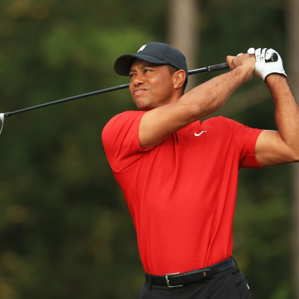 Tiger Woods plays his shot from the second tee during the final round of the PNC Championship at the Ritz-Carlton Golf Club Orlando on Dec. 20, 2020 in Orlando, Florida. (Mike Ehrmann/Getty Images)