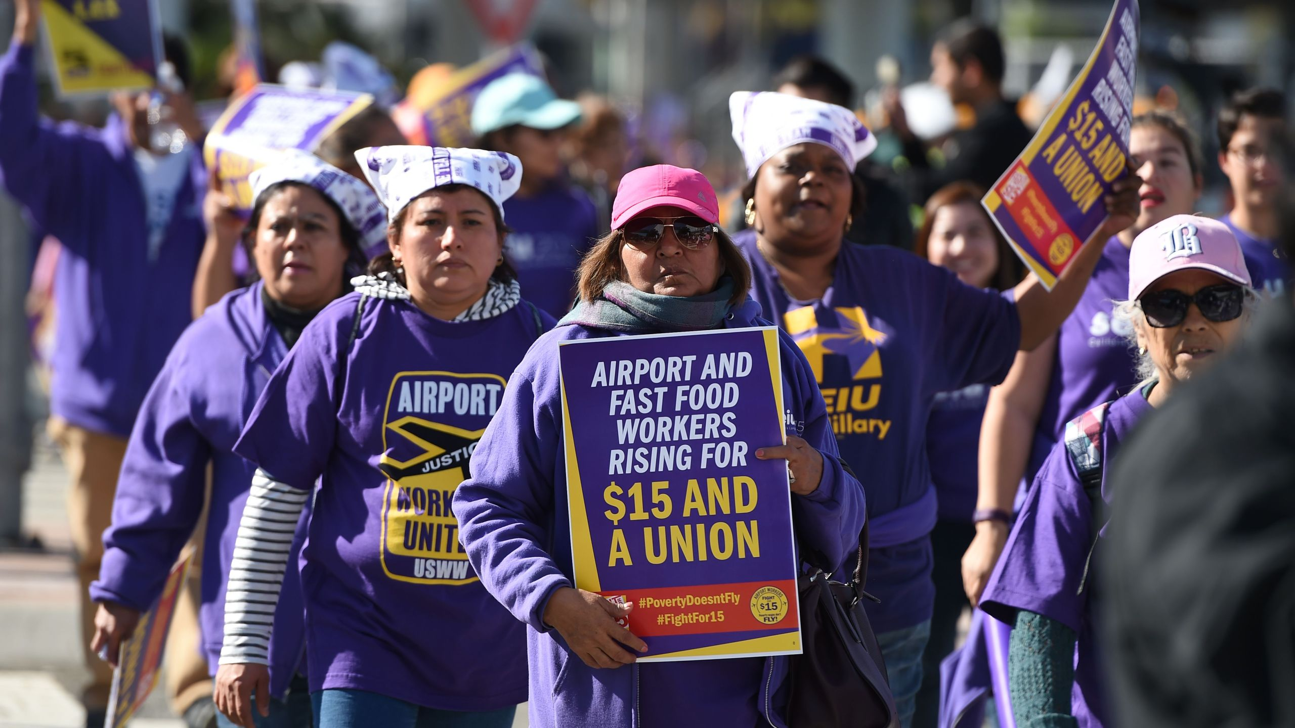 """Union workers and supporters participate in a """"Fight for $15"""" wage protest at Los Angeles International Airport in Los Angeles, on Nov. 29, 2016. Workers from fast-food chains, airports and other service industries rallied in U.S. cities as part of a nationwide day of disruption to demand union rights and a minimum wage of $15 an hour. Workers joining in included cabin cleaners, luggage handlers and other staff at O'Hare, Los Angeles and Fort Lauderdale airports. However, flights were not expected to be disrupted. (Robyn Beck /AFP via Getty Images)"""