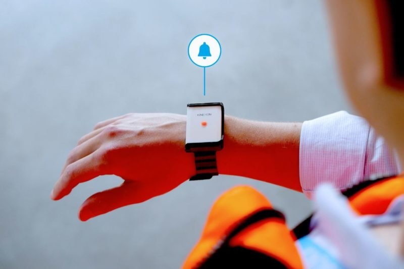 A Kinexon wristband that actively warns the user as soon as the minimum physical distance to another person is compromised. (Kinexon)