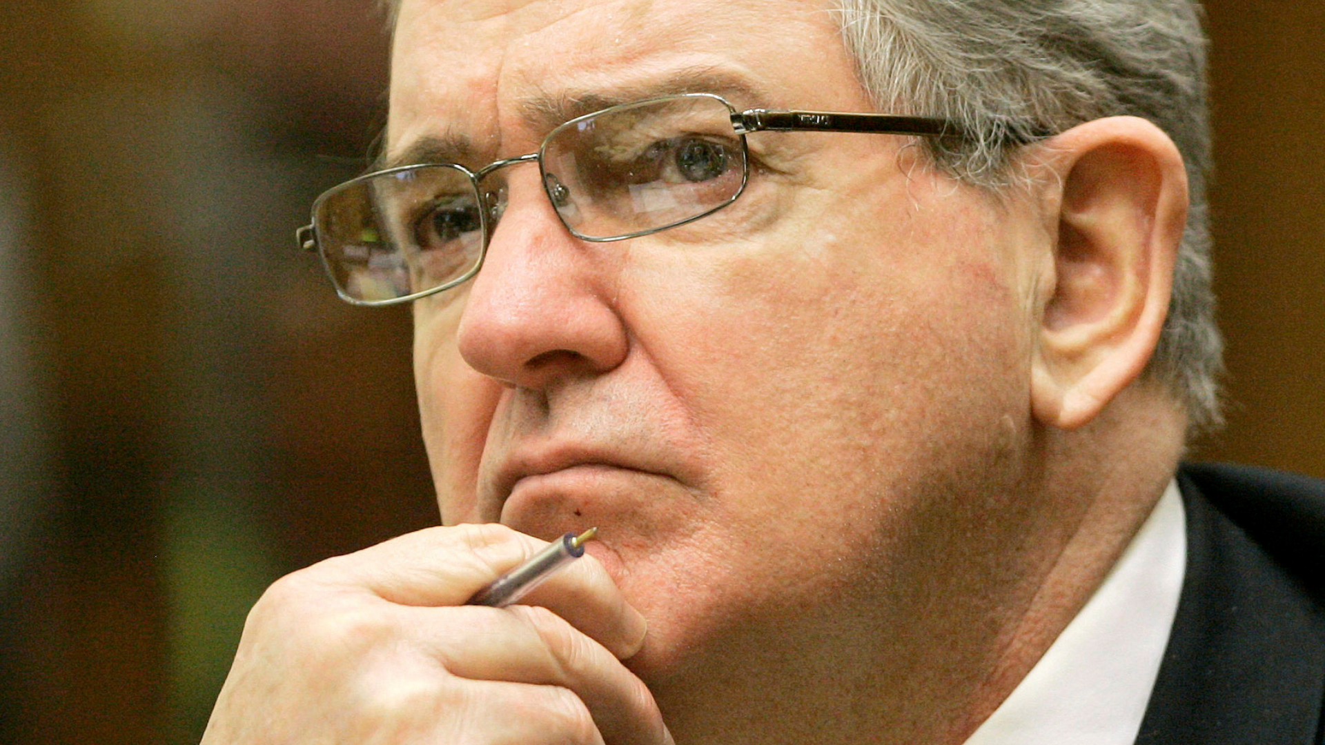 In this Oct. 15, 2008 file photo, former FBI agent John Connolly listens to the testimony during his trial in Miami. (AP Photo/Alan Diaz, File)