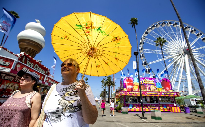 Danica Paz, left, of Sherman Oaks, and Amy Barer, of Los Angeles, attend the 2018 Los Angeles County Fair at the Fairplex in Pomona.(Allen J. Schaben / Los Angeles Times)