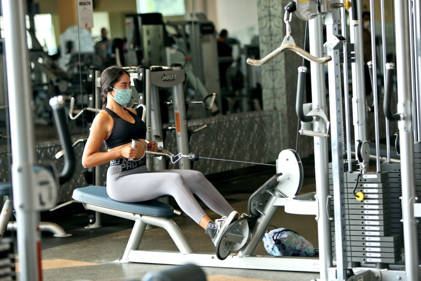 Emily Marczyk of Irvine works out at a 24-Hour Fitness in Costa Mesa in September.(Raul Roa / Times Community News)