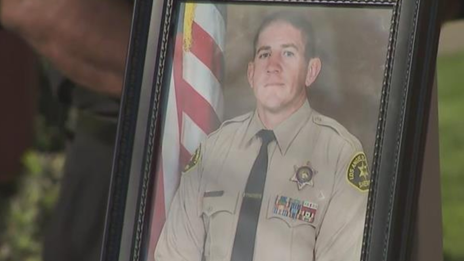 Deputy Thomas Albanese is seen in a photo at a news conference on Feb. 25, 2021. (KTLA)
