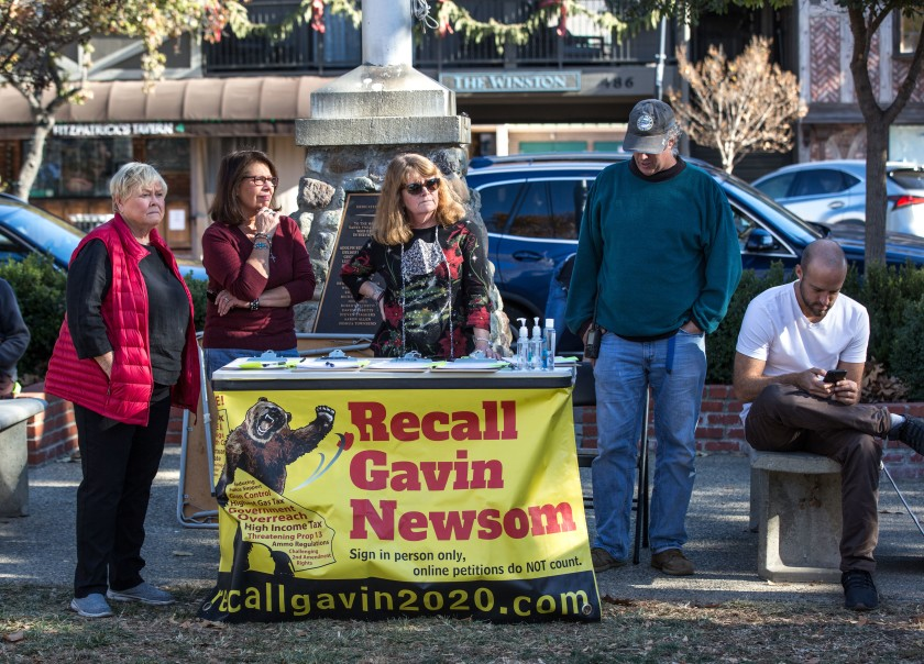 Supporters of an effort to recall Gov. Gavin Newsom collected signatures at a Make America Great Again rally in December 2020 in Solvang. (George Rose / Getty Images)