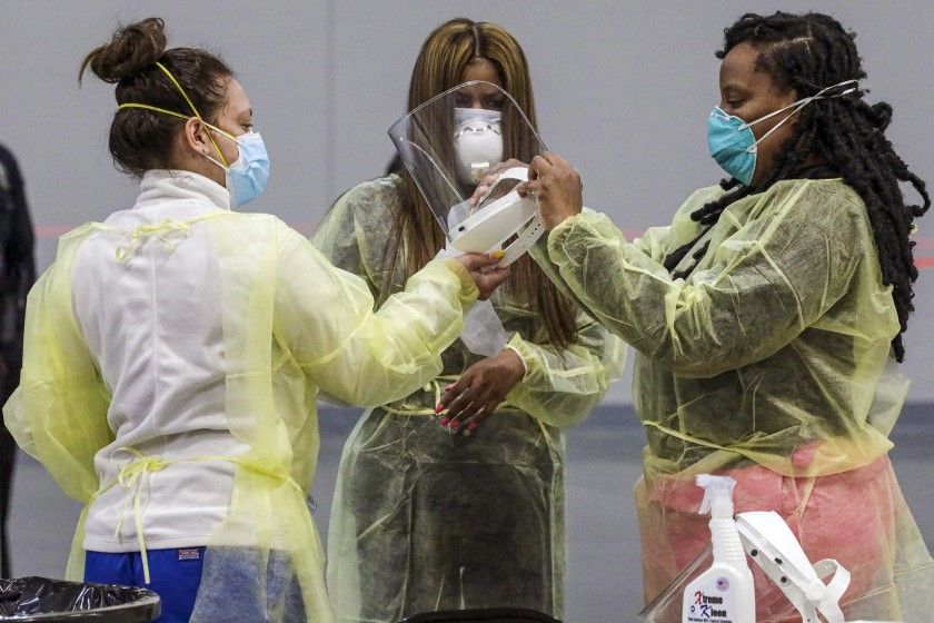 Nurses get ready as the San Bernardino County Department of Public Heath activates the coronavirus vaccination site at the Ontario Convention Center on Thursday in Ontario, Calif.(Irfan Khan / Los Angeles Times)
