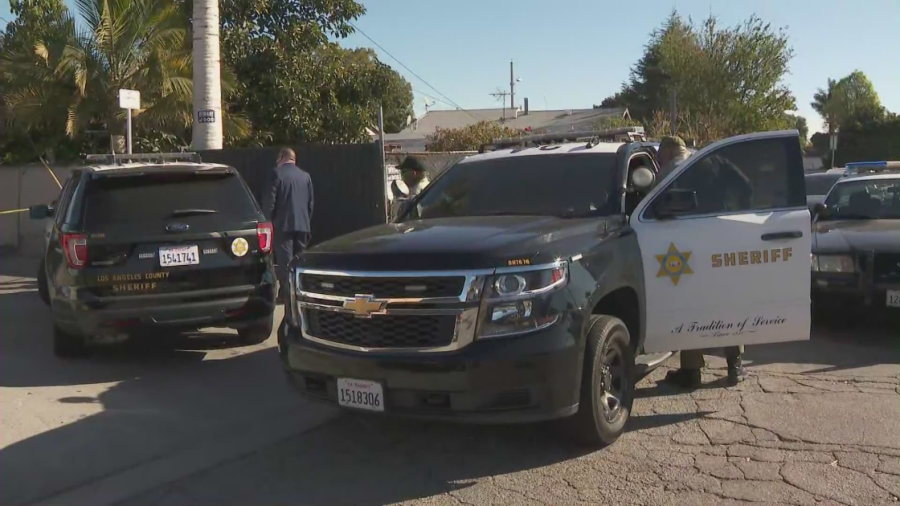 Officials respond to a death investigation in Compton on Feb. 23, 2021. (KTLA)