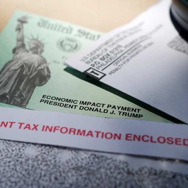 This April 23, 2020, file photo shows a stimulus check issued by the IRS to help combat the adverse economic effects of the COVID-19 outbreak, in San Antonio, Texas. (AP Photo/Eric Gay, File)
