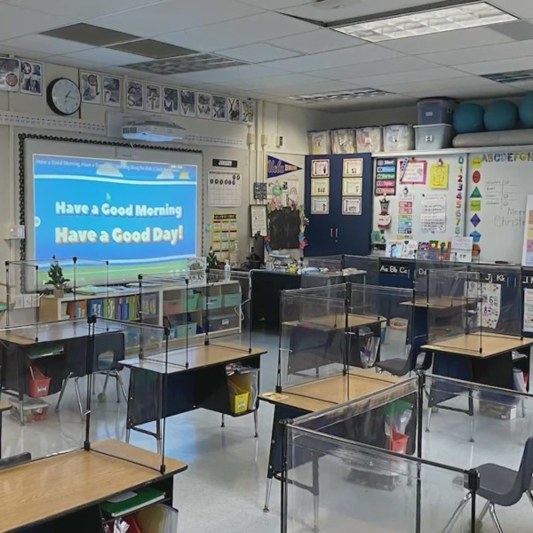 Plexiglass was installed on desks inside a classroom at the Center Street School in El Segundo, where hybrid in-person classes resumed on Feb. 2, 2021. (KTLA)