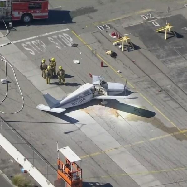 Firefighters respond to the scene of a fatal plane crash in San Pedro on Feb. 19, 2021. (KTLA)