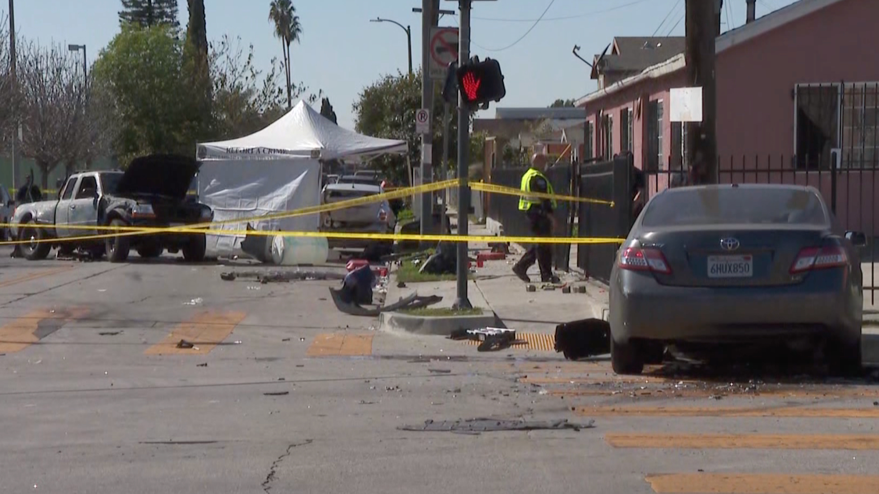 The scene of a crash in South Los Angeles is taped off for investigation after the pickup fatally struck a pedestrian and its occupants fled the scene on Feb. 24, 2021. (KTLA)