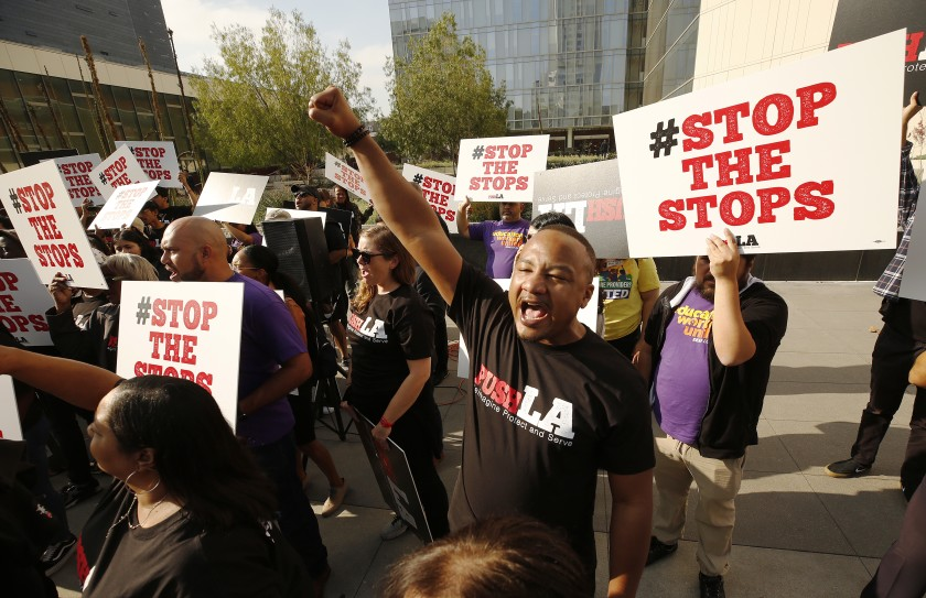 Activists outside LAPD headquarters in 2019 call for an end to LAPD traffic stops in Black and Latino neighborhoods. (Al Seib / Los Angeles Times)