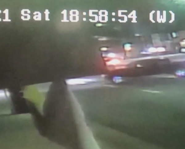 A black truck makes a left turn just before colliding with a motorcyclist in El Monte, killing the other driver on Feb. 20, 2020. The driver of the truck never stopped or tried to help. El Monte police released this surveillance footage the following day as the search for the hit-and-run driver continued.