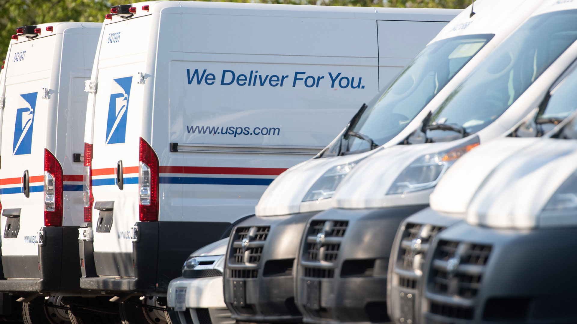 Postal trucks are parked at a U.S. Postal Service post office location in this undated file photo. (Saul Loeb /AFP / Getty Images)