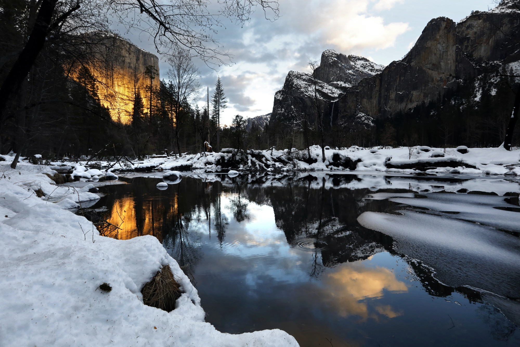 A view of El Capitan is reflected in the Merced River at sunset. The park received several feet of snow during a storm in January 2021. (Carolyn Cole/Los Angeles Times)