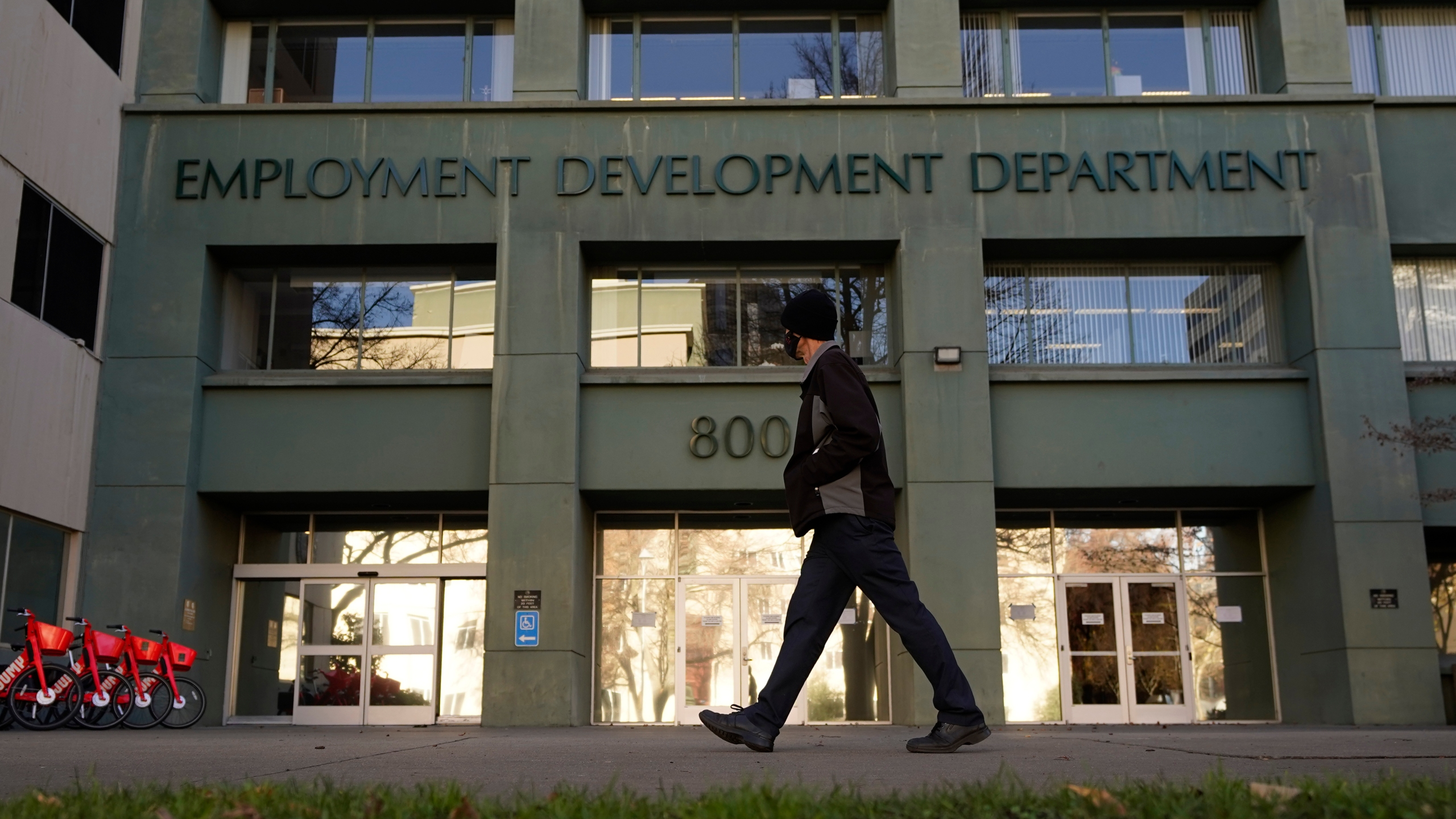 A person passes the office of the California Employment Development Department in Sacramento on Dec. 18, 2020. (Rich Pedroncelli / Associated Press)