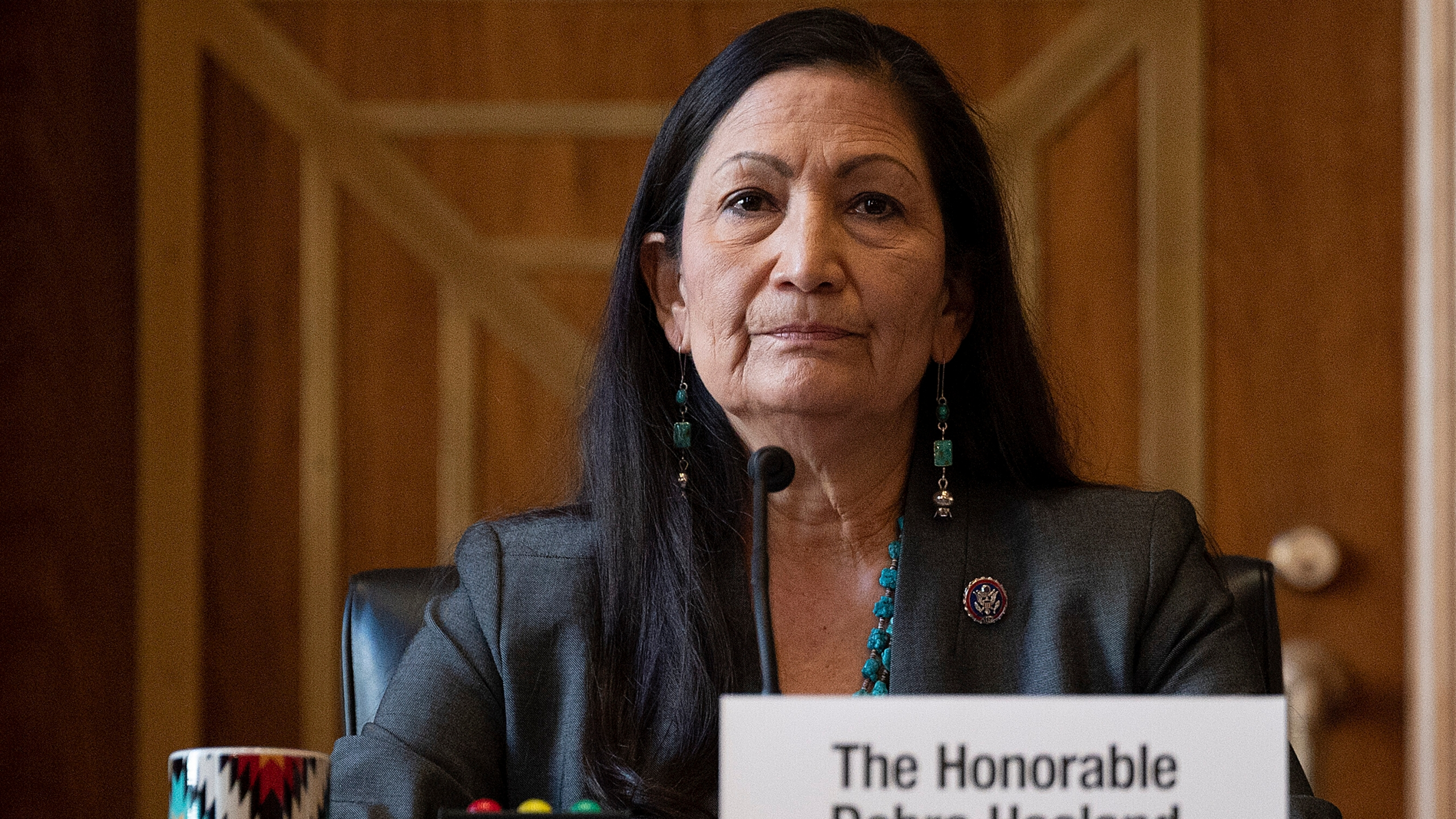 "In this Tuesday, Feb. 23, 2021, file photo, Rep. Deb Haaland, D-N.M., listens during the Senate Committee on Energy and Natural Resources hearing on her nomination to be Interior secretary, on Capitol Hill in Washington. Some Republican senators labeled Haaland ""radical"" over her calls to reduce dependence on fossil fuels and address climate change, and said that could hurt rural America and major oil and gas-producing states. The label of Haaland as a ""radical"" by Republican lawmakers is getting pushback from Native Americans. (Jim Watson/Pool Photo via AP, File)"