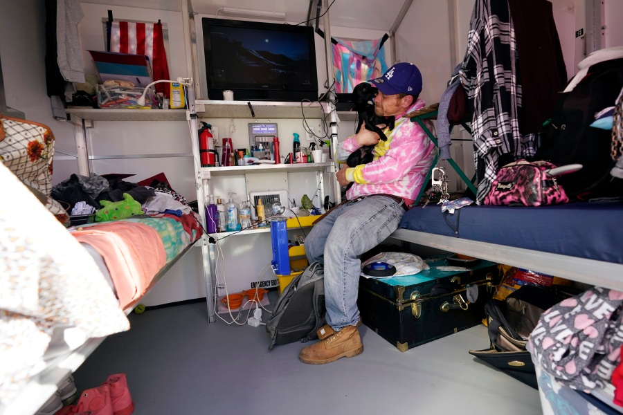 A homeless person, who calls himself Tiffany, sits inside his tiny home on Feb. 25, 2021, in North Hollywood. (AP Photo/Marcio Jose Sanchez)