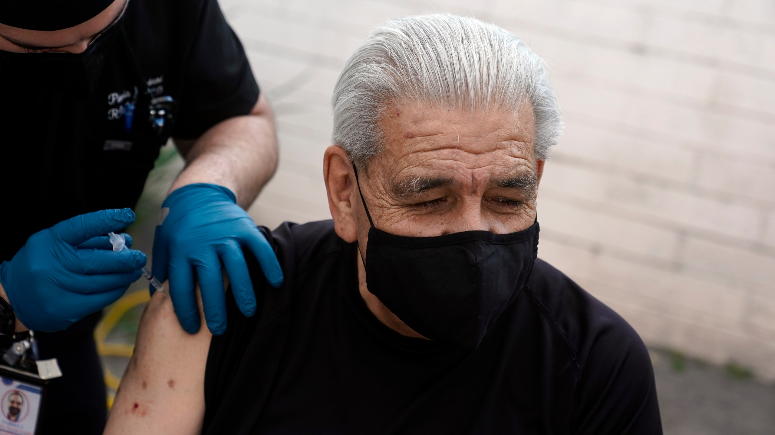 Edward Muro gets a shot of Pfizer's COVID-19 vaccine at Families Together of Orange County Community Health Center in Tustin on Feb. 26, 2021. (Marcio Jose Sanchez / Associated Press)