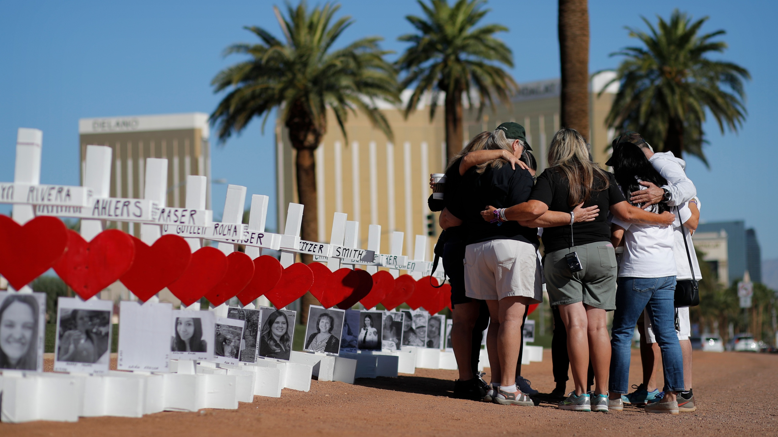 People pray at a makeshift memorial for shooting victims in Las Vegas on Oct. 1, 2019, the anniversary of the mass shooting two years earlier. (John Locher / Associated Press)