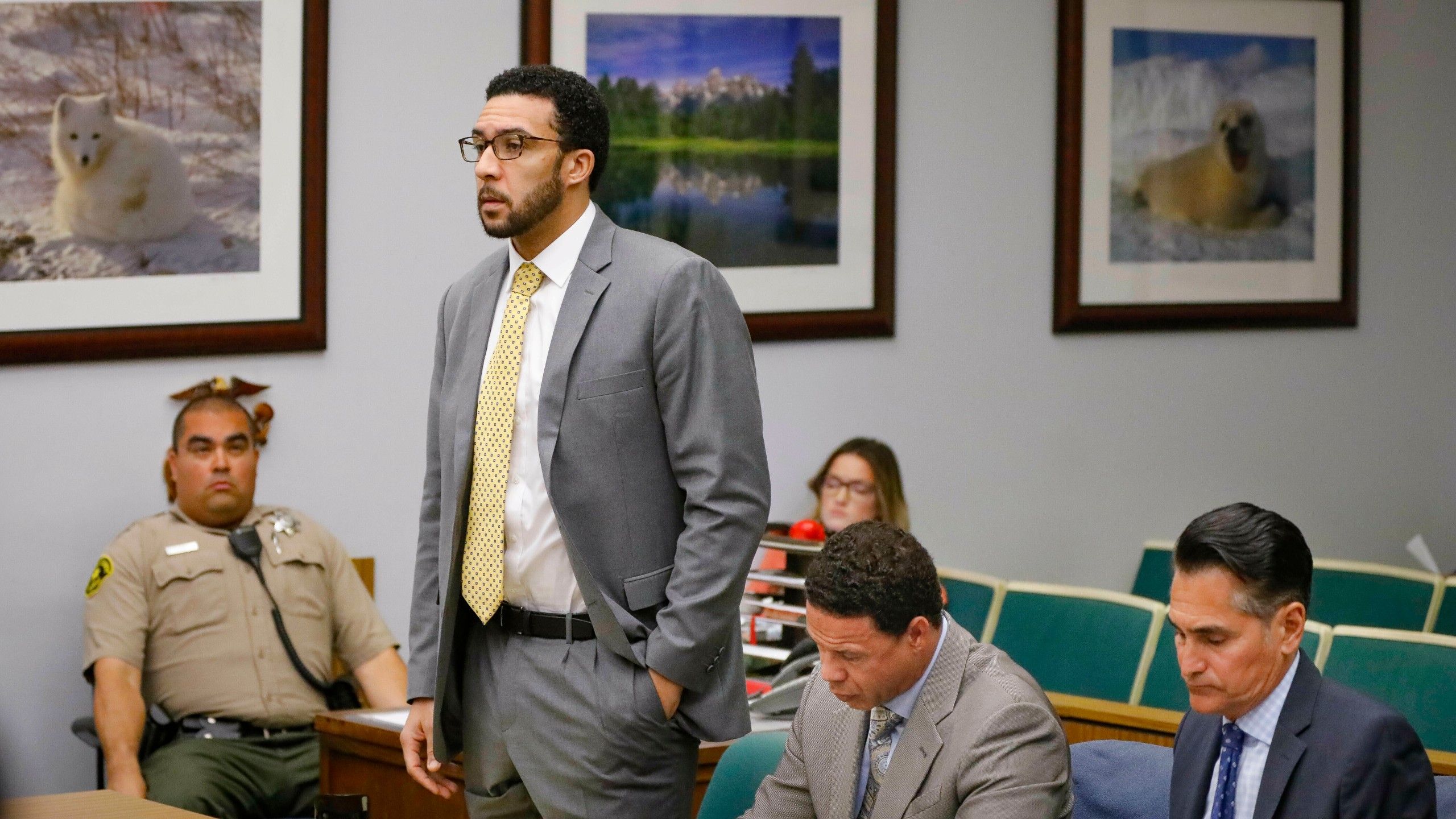 In this June 14, 2019, file photo Ex-NFL player Kellen Winslow II, standing, who was accused of committing several sex crimes against women in North County last year, including rape, answers a question from San Diego County Superior Court Vista Judge Blaine Bowman during a status hearing in Vista, Calif. (Howard Lipin/The San Diego Union-Tribune via AP, Pool,File)