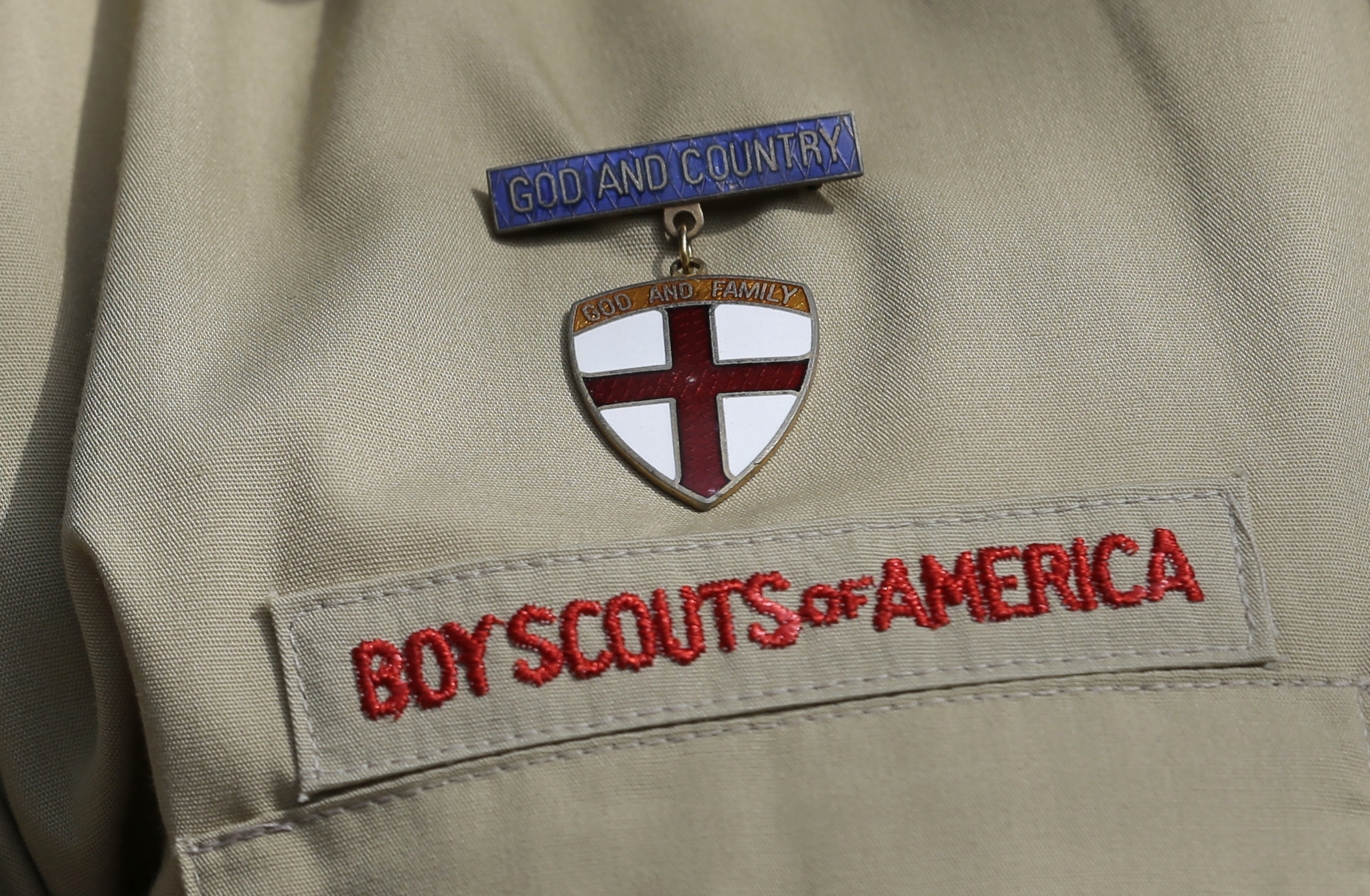 A detail of a Boy Scout uniform is seen during a news conference in front of the Boy Scouts of America headquarters in Irving, Texas, on Feb. 4, 2013. (Tony Gutierrez / Associated Press)