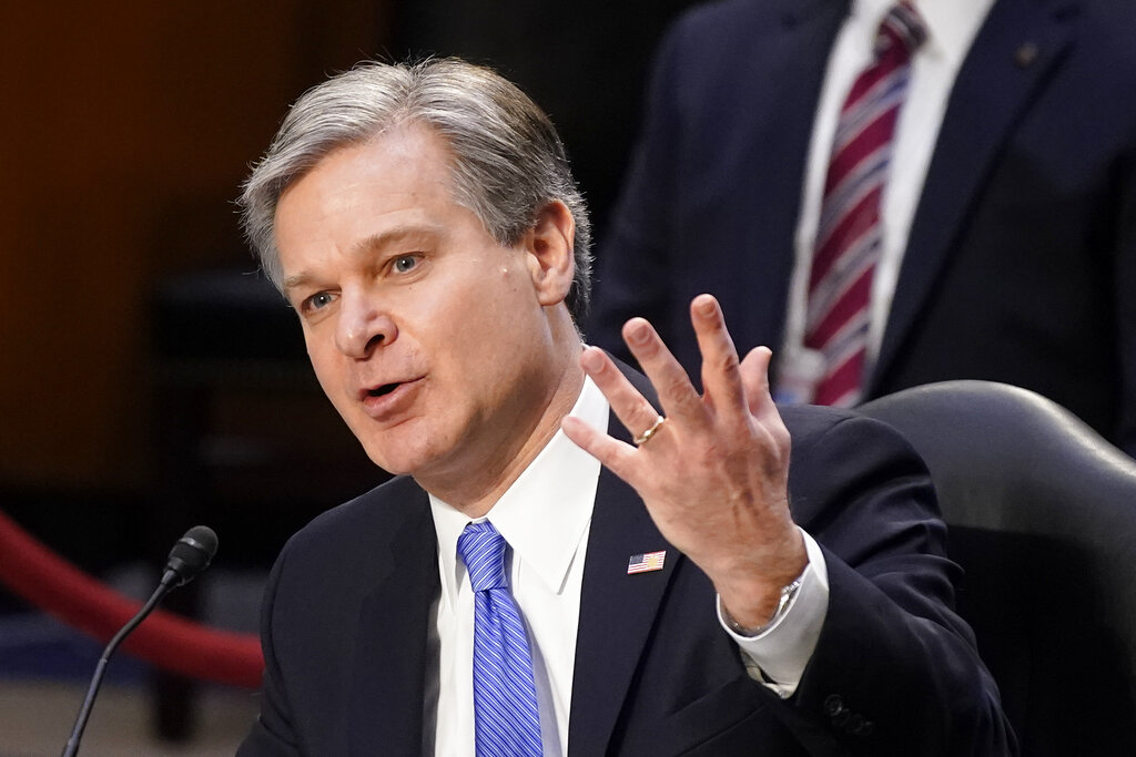 FBI Director Christopher Wray testifies before the Senate Judiciary Committee on Capitol Hill in Washington, Tuesday, March 2, 2021. (AP Photo/Patrick Semansky)