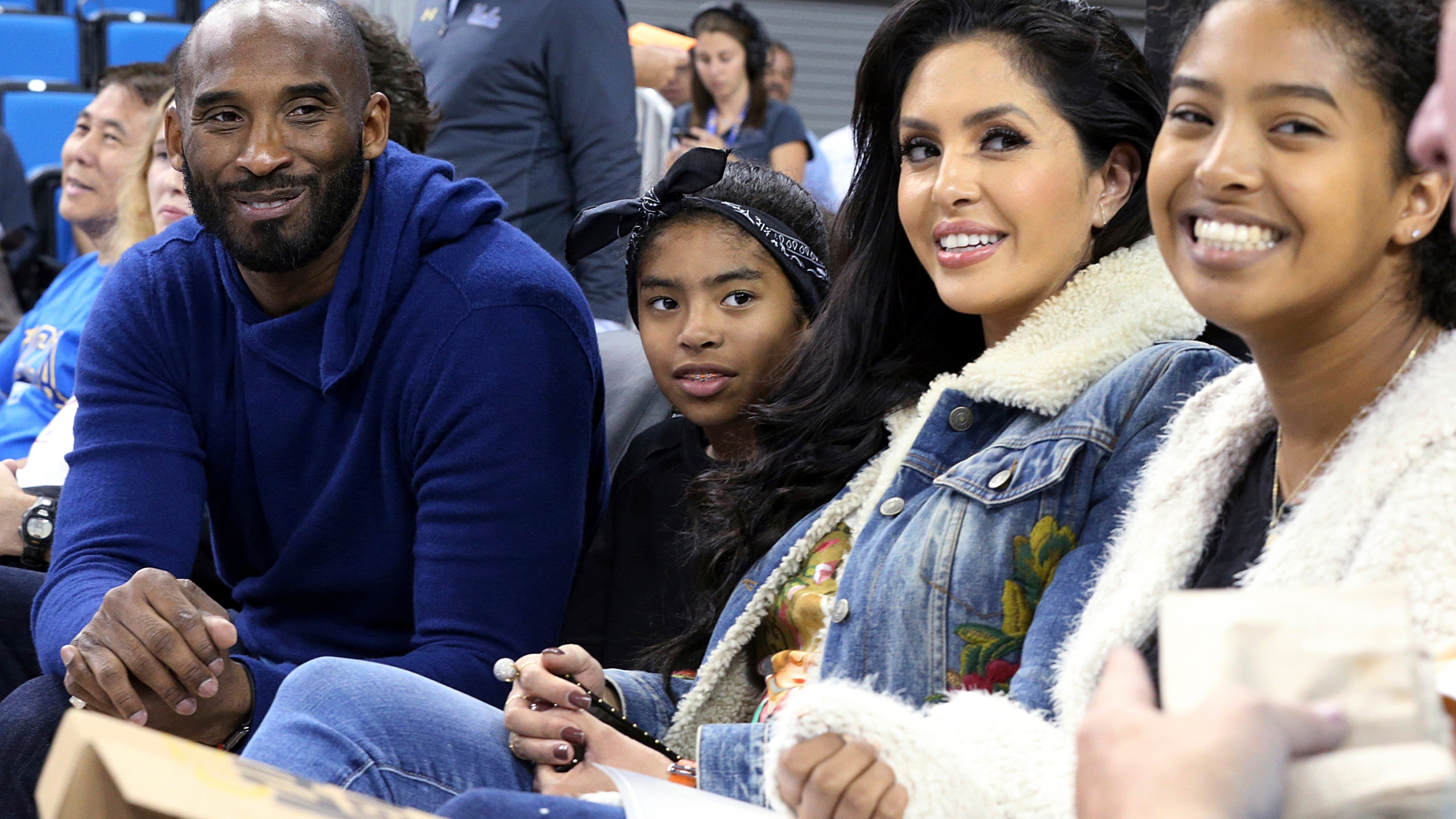 "In this Nov. 21, 2017, file photo, from left, Los Angeles Lakers legend Kobe Bryant, his daughter Gianna Maria-Onore Bryant, wife Vanessa and daughter Natalia Diamante Bryant are seen before an NCAA college women's basketball game between Connecticut and UCLA, in Los Angeles. Vanessa Bryant says she is focused on ""finding the light in darkness"" in an emotional story in People magazine. She details how she attempts to push forward after her husband, Kobe Bryant, and daughter Gigi died in a helicopter crash in early 2020. (AP Photo/Reed Saxon, File)"