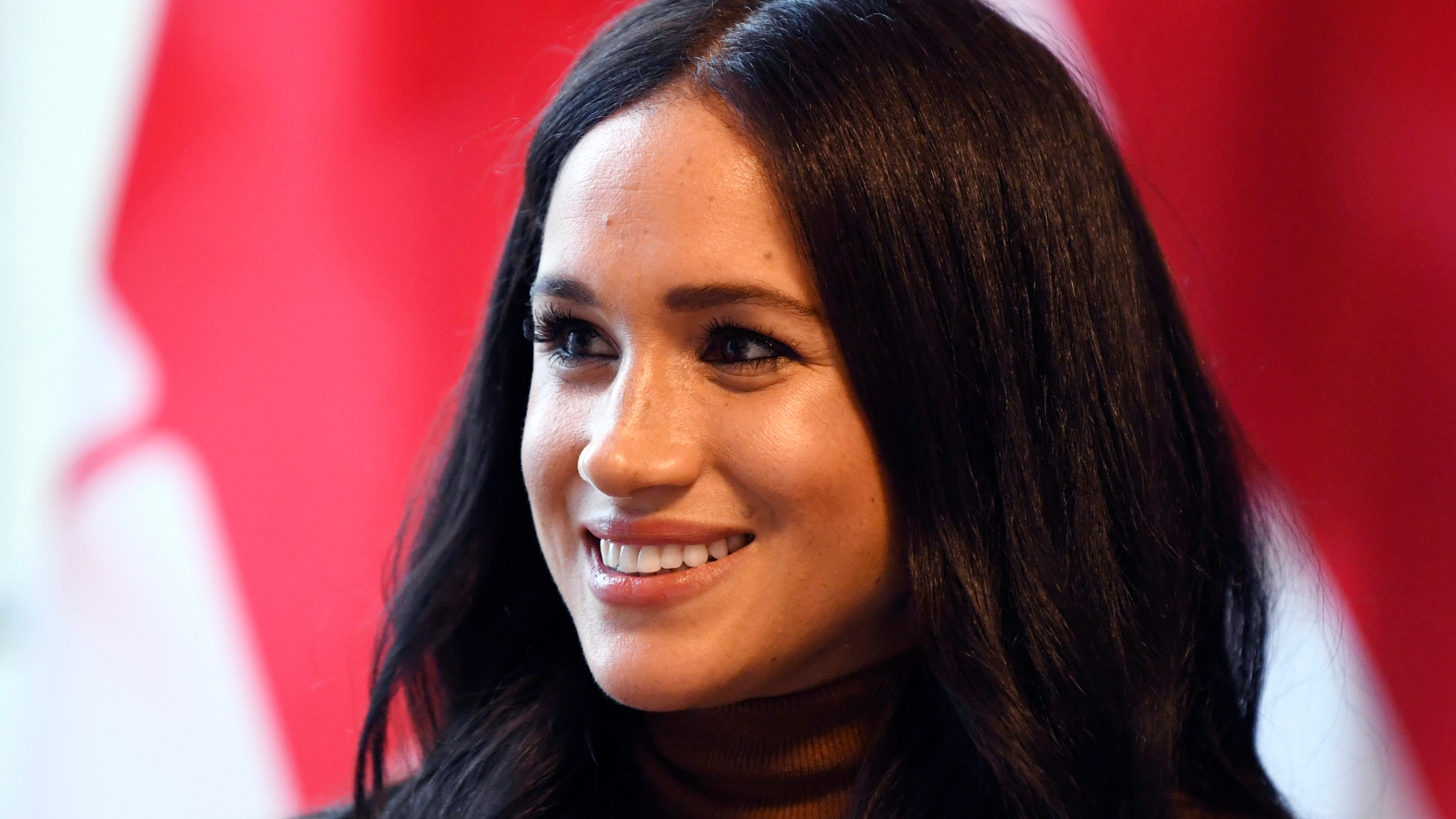 In this Jan. 7, 2020 file photo, Meghan, Duchess of Sussex smiles during her visit with Prince Harry to Canada House in London. (Daniel Leal-Olivas/Pool Photo/Associated Press)