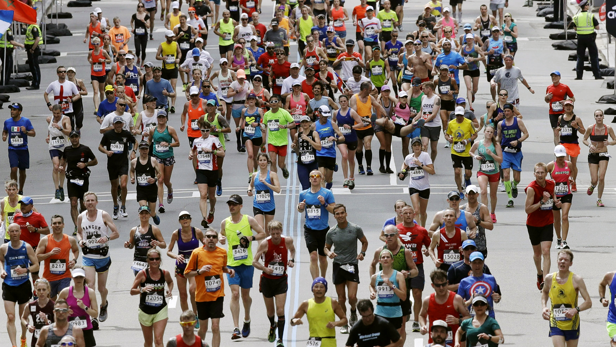 In this April 17, 2017, file photo, runners head down the stretch to the finish line in the 121st Boston Marathon in Boston. (AP Photo/Charles Krupa, File)