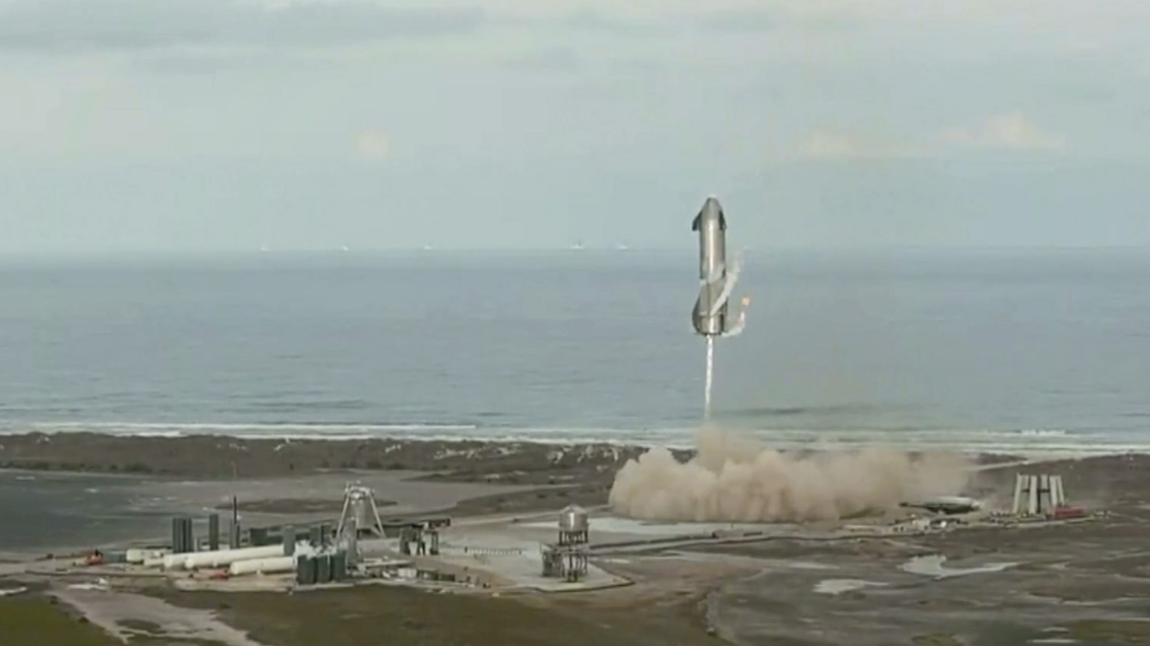 In this image from video made available by SpaceX, one of the company's Starship prototypes fires its thrusters as it lands during a test in Boca Chica, Texas, on March 3, 2021. SpaceX's futuristic Starship looked like it aced a touchdown, but then exploded on the landing pad with so much force that it was hurled into the air.