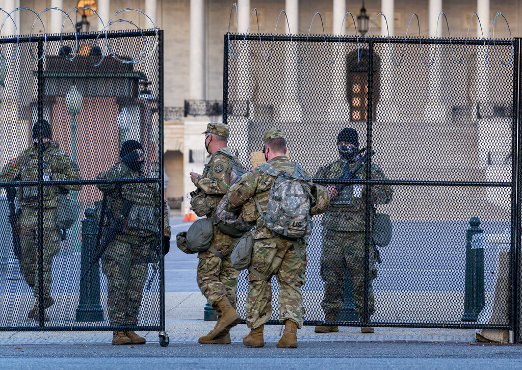 "National Guard troops keep watch at the Capitol in Washington, early Thursday, March 4, 2021, amid intelligence warnings that there is a ""possible plot"" by a group of militia extremists to take control of the Capitol on March 4 to remove Democrats from power. (AP Photo/J. Scott Applewhite)"