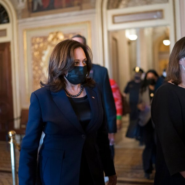 Vice President Kamala Harris arrives to break the tie on a procedural vote as the Senate works on the Democrats' $1.9 trillion COVID relief package, on Capitol Hill in Washington, Thursday, March 4, 2021. (AP Photo/J. Scott Applewhite)