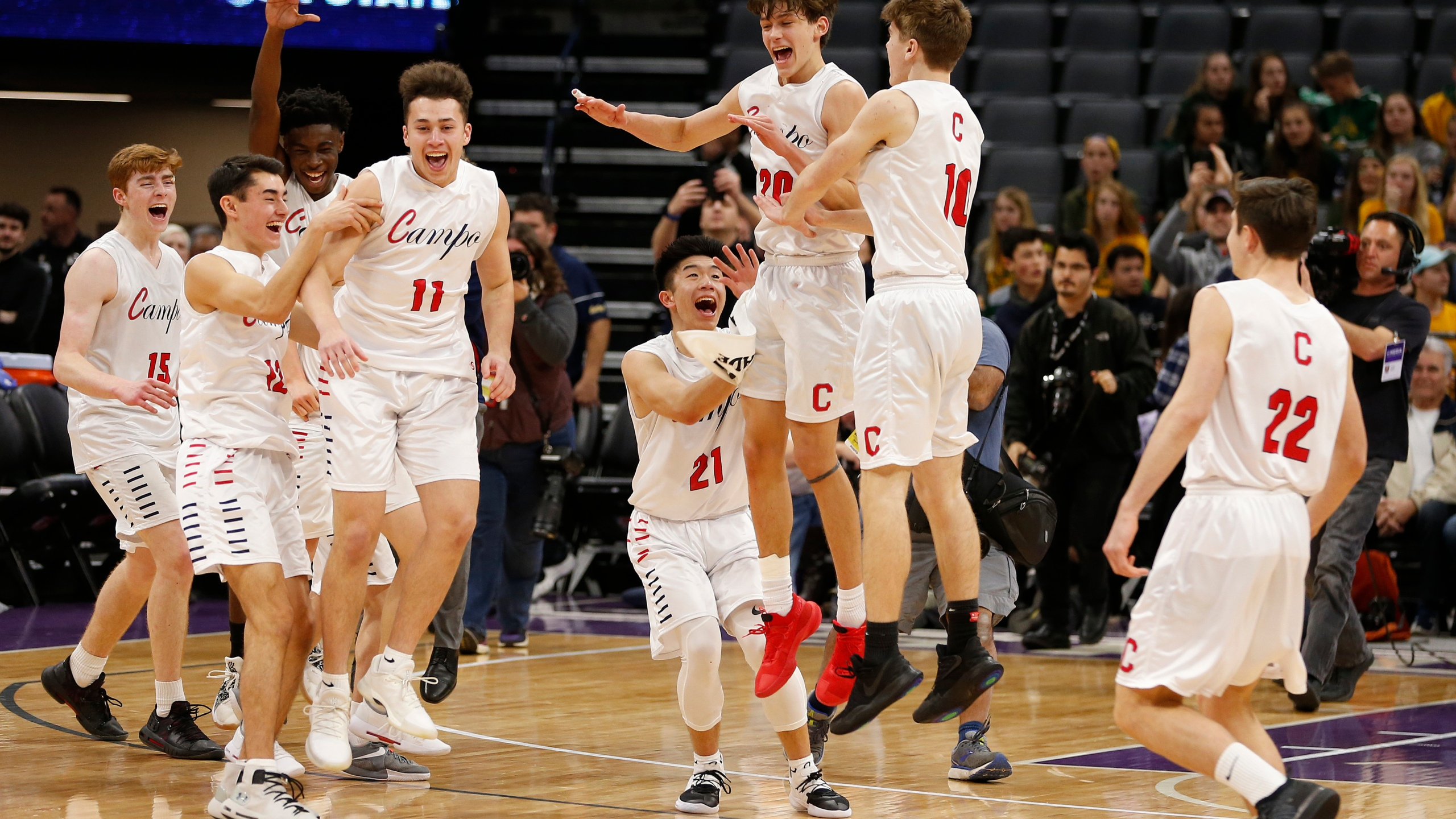 Campolindo players celebrate a win over Colony in the CIF boys' Division II state high school basketball championship game in Sacramento on March 9, 2019. (Rich Pedroncelli / Associated Press)