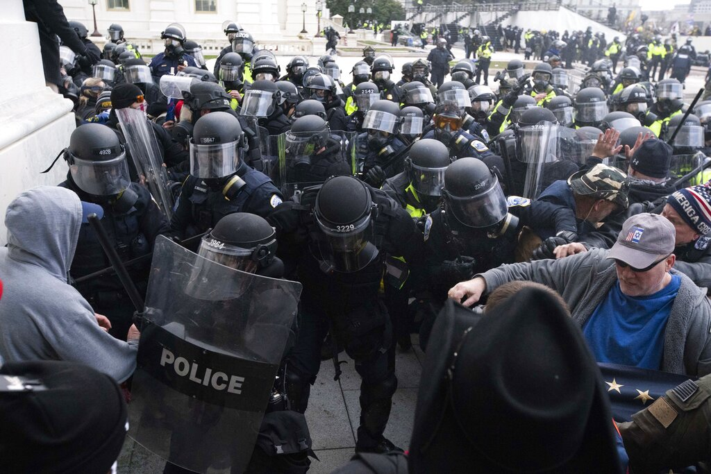 In this Jan. 6, 2021, file photo, U.S. Capitol Police push back rioters trying to enter the U.S. Capitol in Washington. (AP Photo/Jose Luis Magana, File)