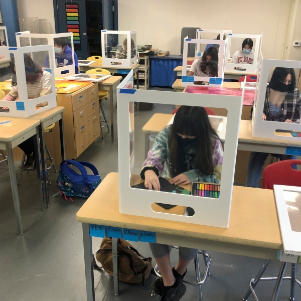 In this March 2, 2021, file photo, socially distanced and with protective partitions students work on an art project during class at the Sinaloa Middle School in Novato, Calif. (Haven Daley/Associated Press)