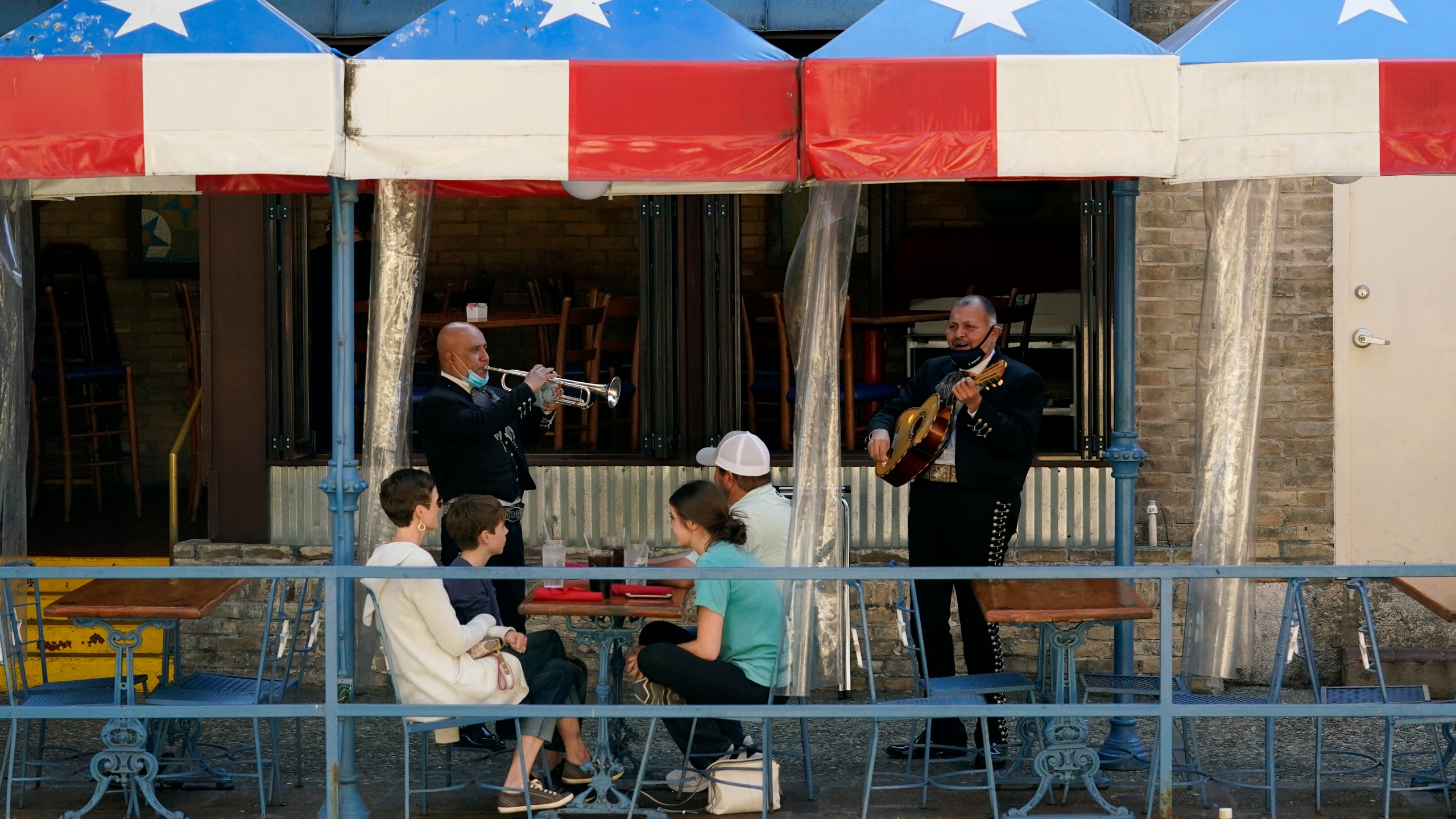 Mariachi perform for diners at a restaurant on the River Walk in San Antonio on March 3, 2021. (Eric Gay / Associated Press)