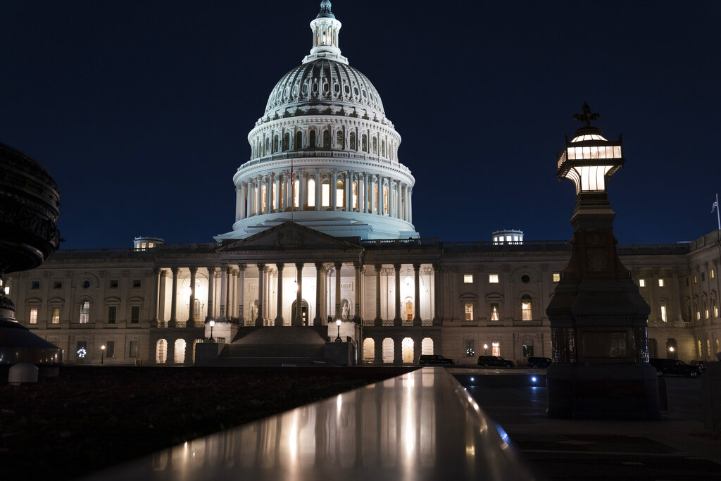 The Capitol is seen at dusk as work in the Senate is stalled on the Democrats' $1.9 trillion COVID-19 relief bill, in Washington, Friday, March 5, 2021. (AP Photo/J. Scott Applewhite)