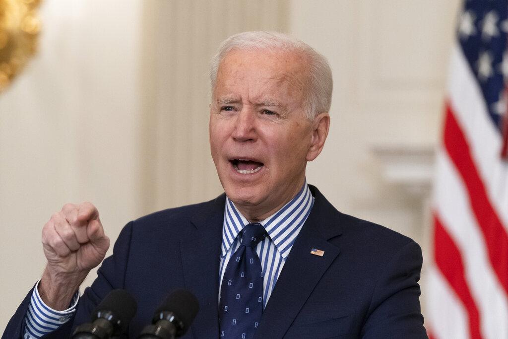 President Joe Biden speaks in the State Dining Room of the White House, Saturday, March 6, 2021, in Washington. (AP Photo/Alex Brandon)
