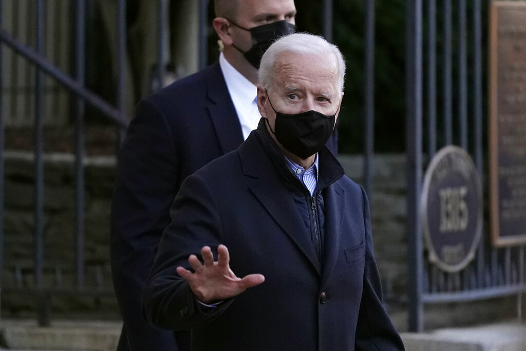 President Joe Biden departs after attending Mass at Holy Trinity Catholic Church in the Georgetown neighborhood of Washington, Saturday, March 6, 2021. (AP Photo/Patrick Semansky)