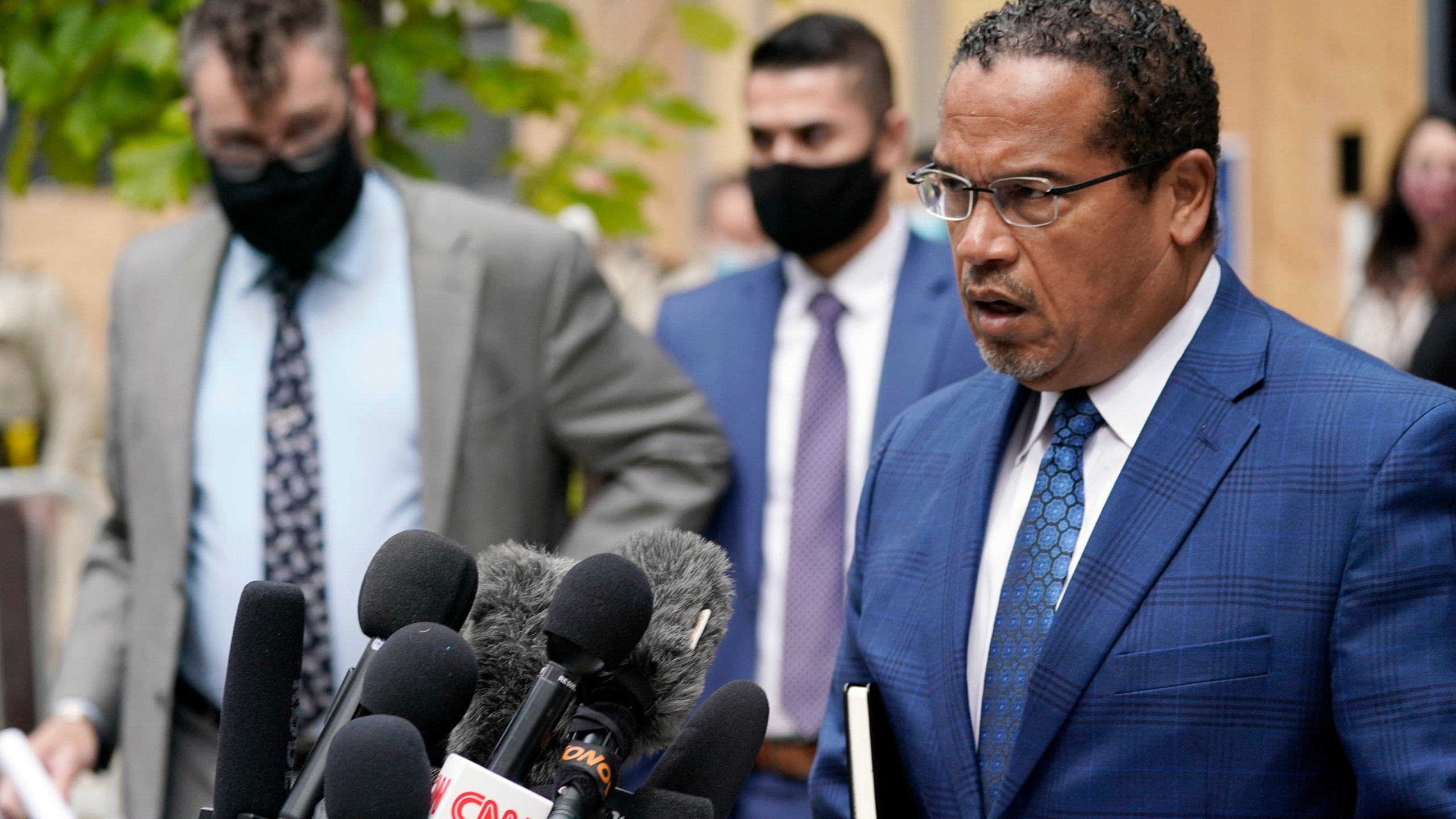 In this Sept. 11, 2020 file photo, Minnesota Attorney General Keith Ellison, right, addresses reporters outside the Hennepin County Family Justice Center in Minneapolis. (AP Photo/Jim Mone, File)In this Sept. 11, 2020 file photo, Minnesota Attorney General Keith Ellison, right, addresses reporters outside the Hennepin County Family Justice Center in Minneapolis. (AP Photo/Jim Mone, File)