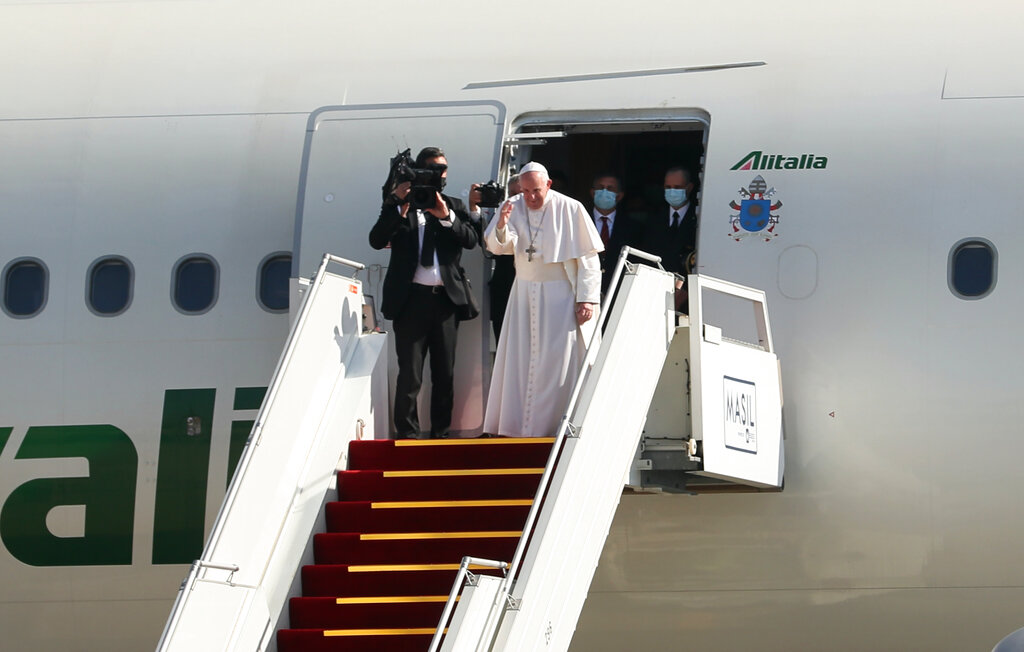 Pope Francis, font right, bids farewell upon concluding his visit to Iraq at Baghdad airport, Iraq, Monday, March 8, 2021. (AP Photo/Khalid Mohammed)
