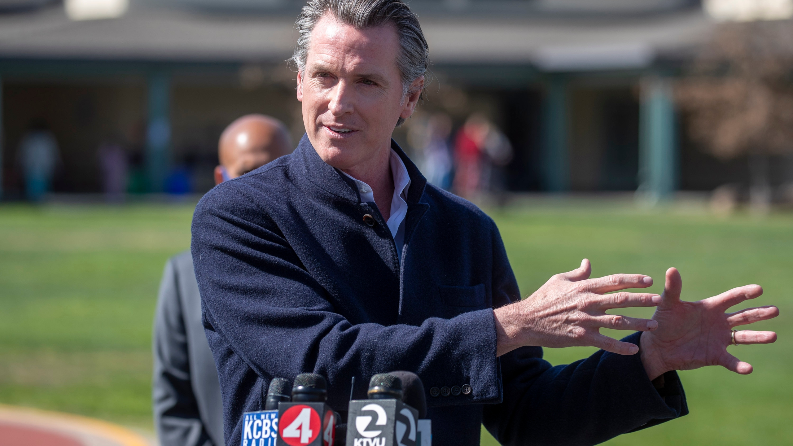 California Gov. Gavin Newsom speaks about the state's plan to reopen schools as coronavirus vaccinations continue during a news conference on the schoolyard at Barron Park Elementary in Palo Alto on March 2, 2021. (Karl Mondon / Bay Area News Group via Associated Press)