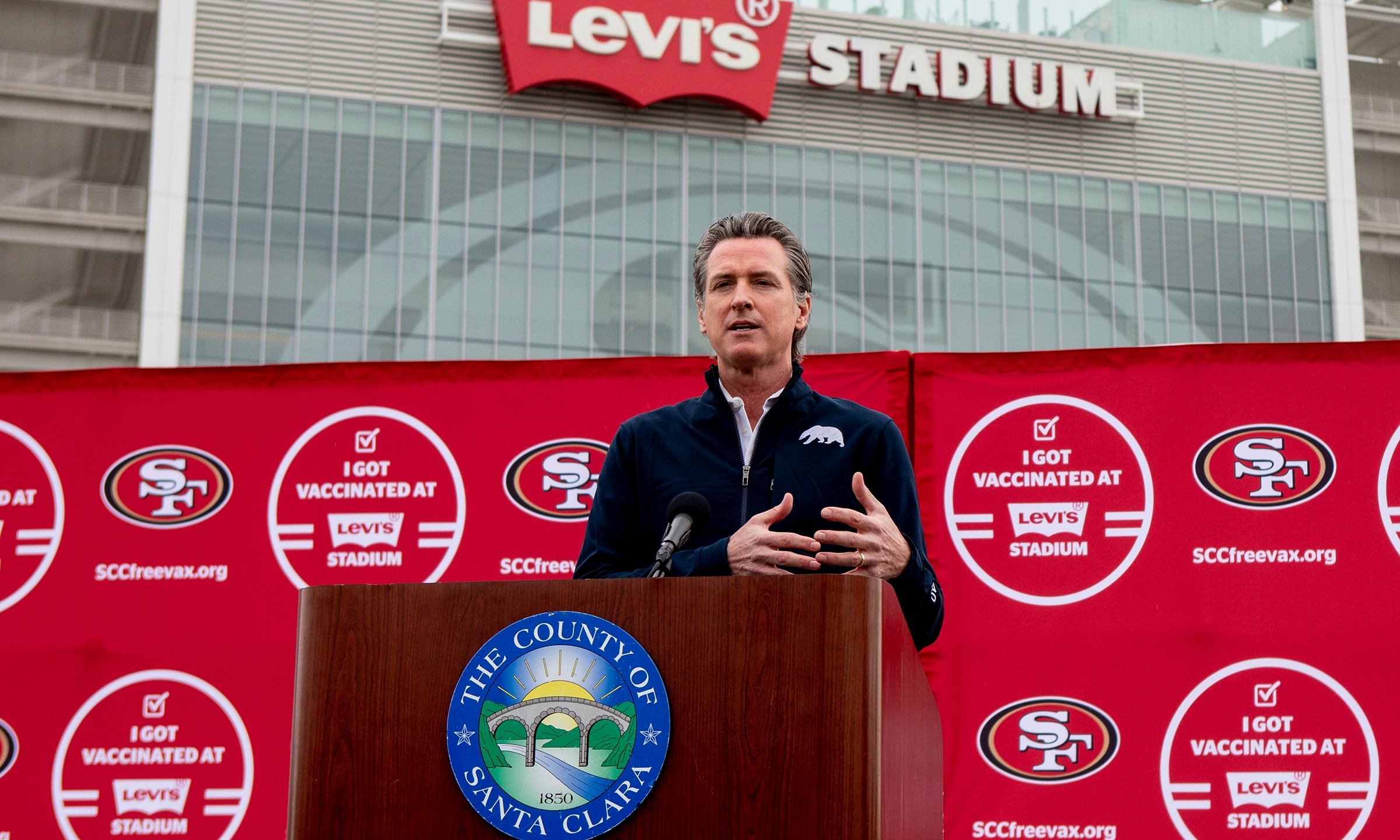 In this Feb. 9, 2021, file photo, California Gov. Gavin Newsom speaks at a press conference outside of Levi's Stadium, in Santa Clara, Calif., before the opening of the largest mass coronavirus vaccination site in the state. (Karl Mondon/Bay Area News Group via AP, File)