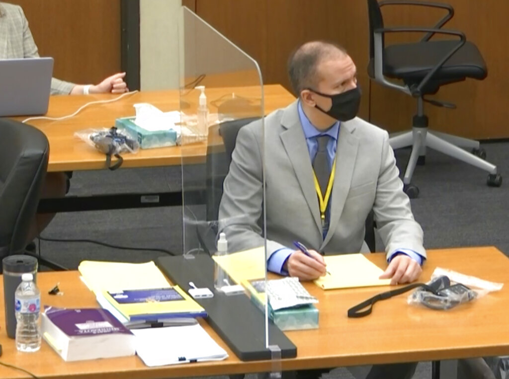 In this image from video, defendant and former Minneapolis police officer Derek Chauvin, right, listens as Hennepin County Judge Peter Cahill presides over pretrial motions before jury selection Tuesday, March 9, 2021 at the Hennepin County Courthouse in Minneapolis. (Court TV, via AP, Pool)
