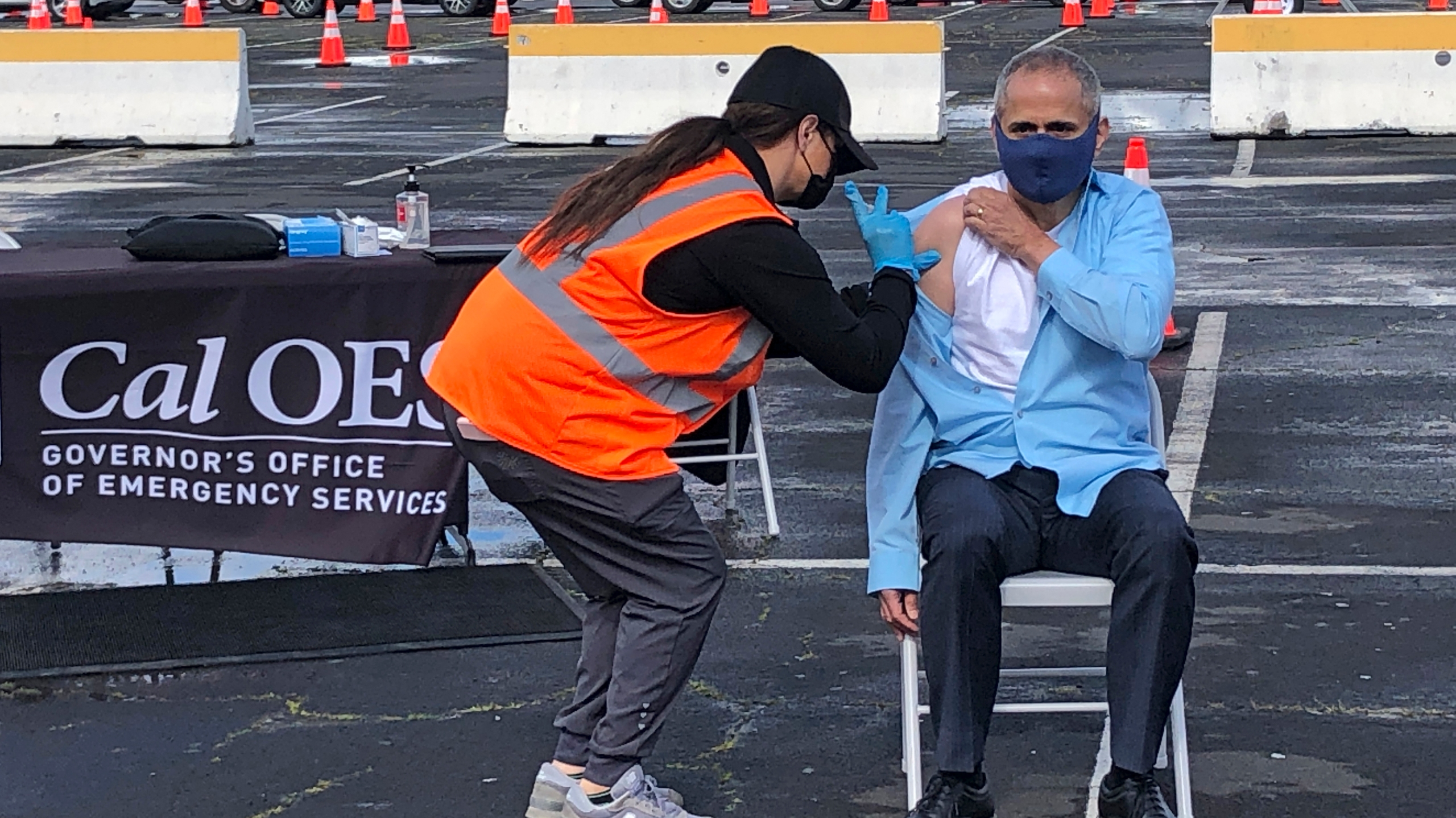 Dr. Tomas Aragon, State Public Health Officer and California Department of Public Health Director, takes part in a vaccination event at the RingCentral Coliseum in Oakland, Calif., on Thursday, March 11, 2021, to highlight the new one-dose Janssen COVID-19 vaccine by Johnson & Johnson. (AP Photo/Haven Daley)