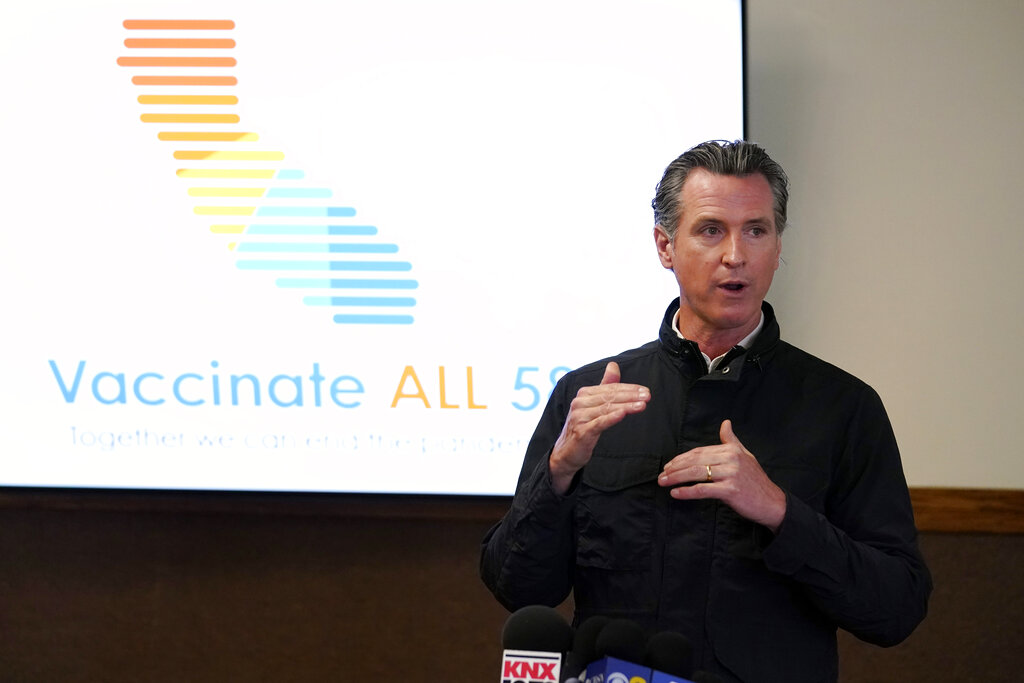 In this March 10, 2021 file photo, California Gov. Gavin Newsom addresses the media during a visit to a vaccination center in South Gate, Calif. (AP Photo/Marcio Jose Sanchez, File)