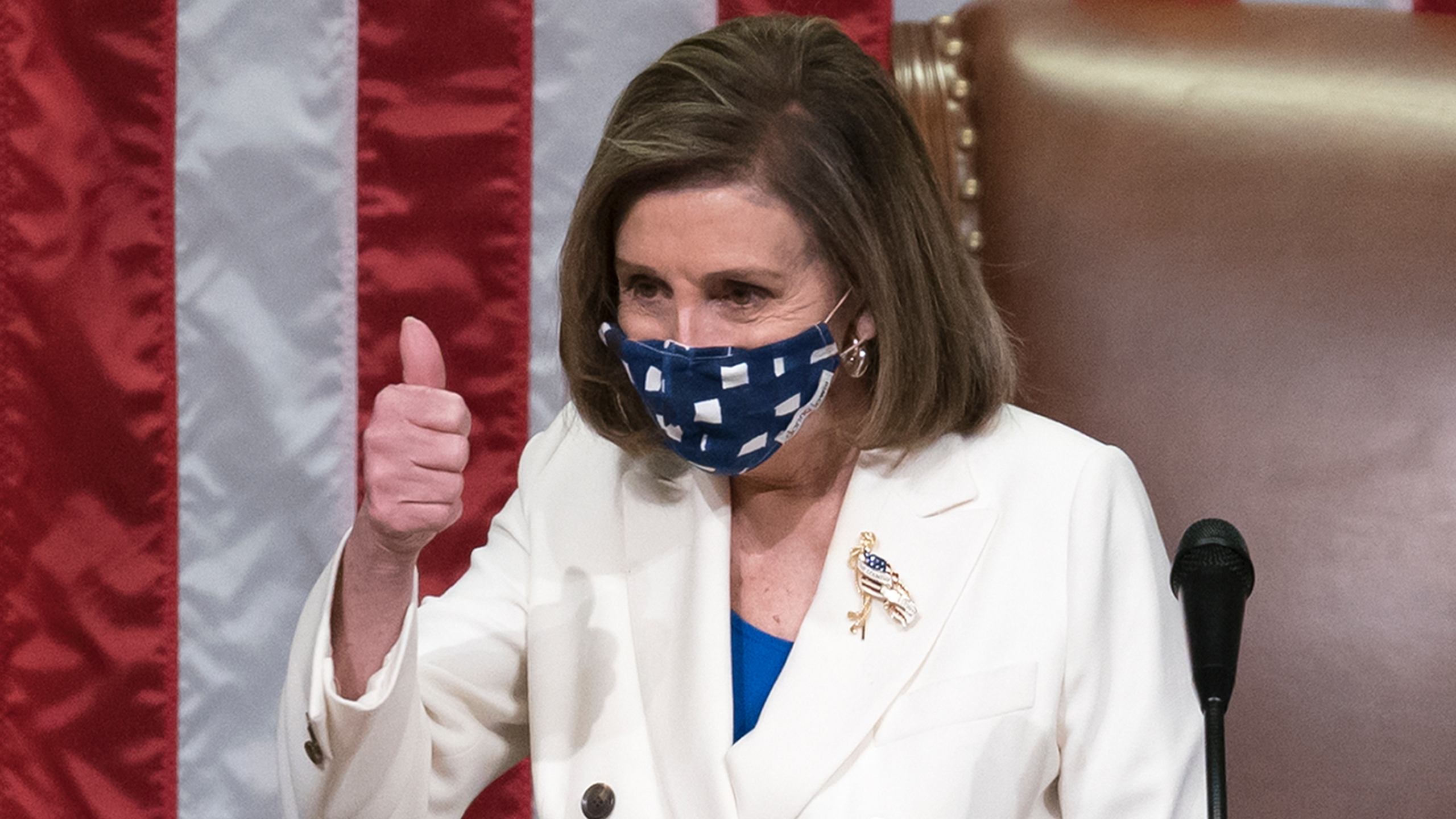 Speaker of the House Nancy Pelosi, D-Calif., gestures after the $1.9 trillion COVID-19 relief bill was passed at the Capitol in Washington on March 10, 2021. (J. Scott Applewhite / Associated Press)